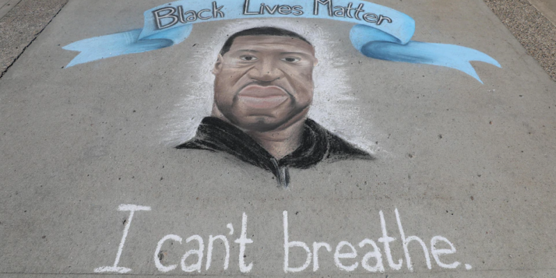 "A chalk portrait of George Floyd that says ""Black Lives Matter"" and ""I can't breate."""